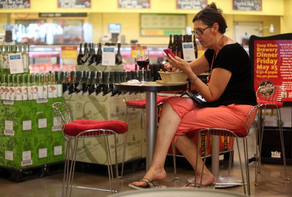 Glenda Emery relaxed with a salad and a glass of red wine recently at a table in  Whole Foods on Park Lane.