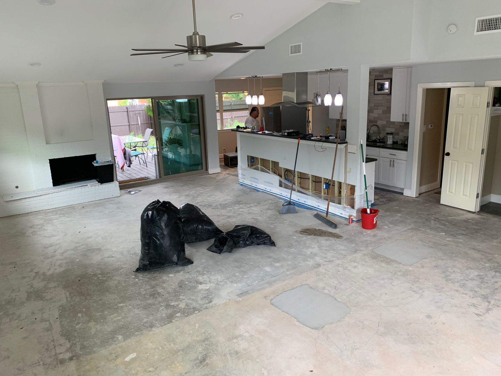 Ryan Hines' living and dining area at his newly purchased Northwest Dallas home as it underwent renovations to repair a sinking foundation. Hines spent nearly $40,000 post-purchase on what he described as necessary repairs for the home.