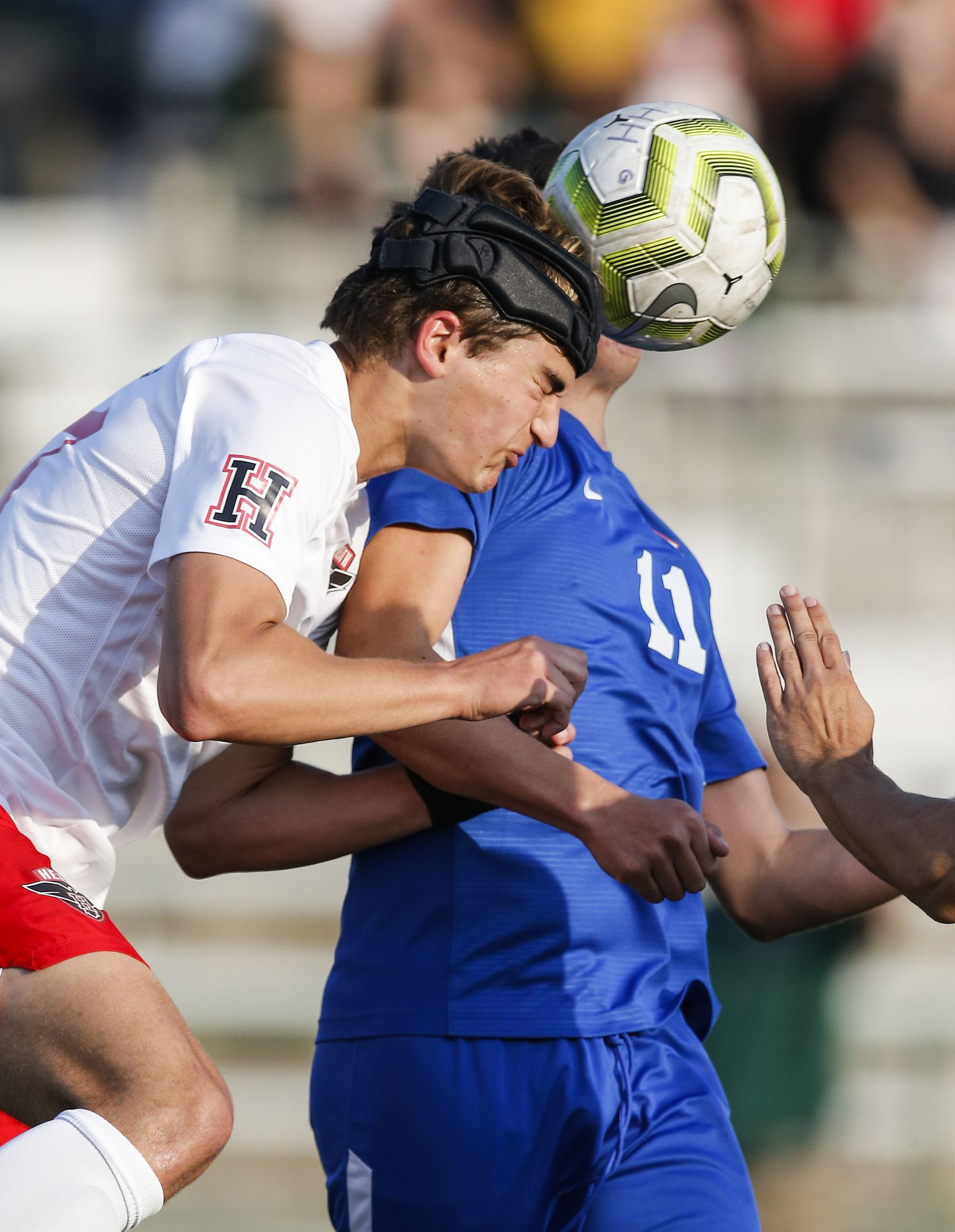Rockwall-Heath freshman defender Fletcher Fierro, left, heads the ball away from Allen senior midfielder Bryan Vallejo (11) during the first half of a boys soccer Class 6A state semifinal at Mesquite Memorial Stadium in Mesquite, Tuesday, April 13, 2021. (Brandon Wade/Special Contributor)