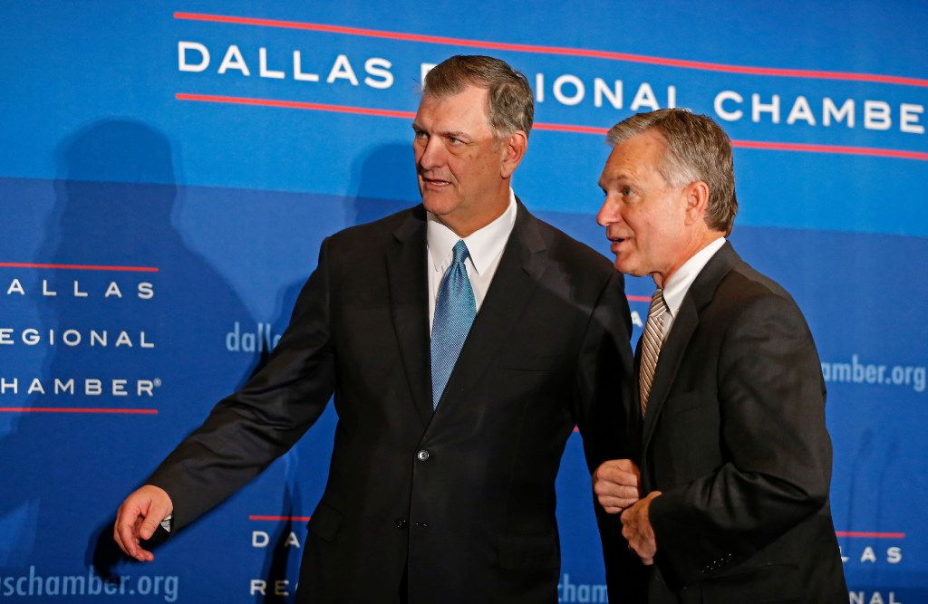 Dallas Mayor Mike Rawlings (left) and Dale Petroskey, President and CEO of Dallas Regional Chamber get ready for a group photo onstage during State of the City Luncheon at Omni Dallas Hotel in Dallas, Thursday, Dec. 8, 2016. Mayor Rawlings spoke about a variety of topics including the Dallas Police and Fire Pension. (Jae S. Lee/The Dallas Morning News)
