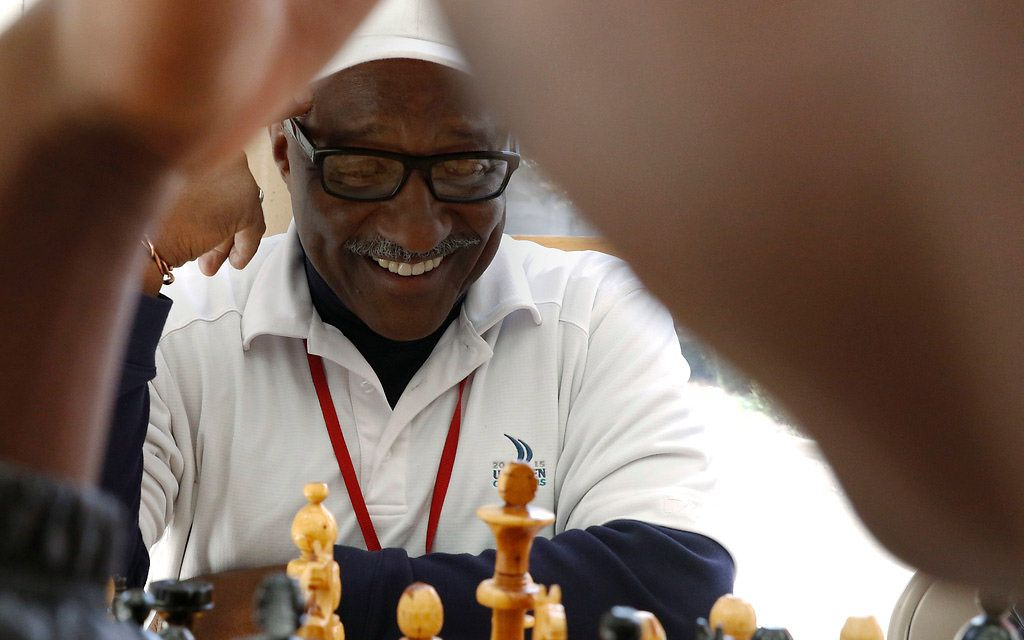 Donald Harris plays chess with Duncanville High School student Gerald Watson during lunch in the school's cafeteria in early December.
