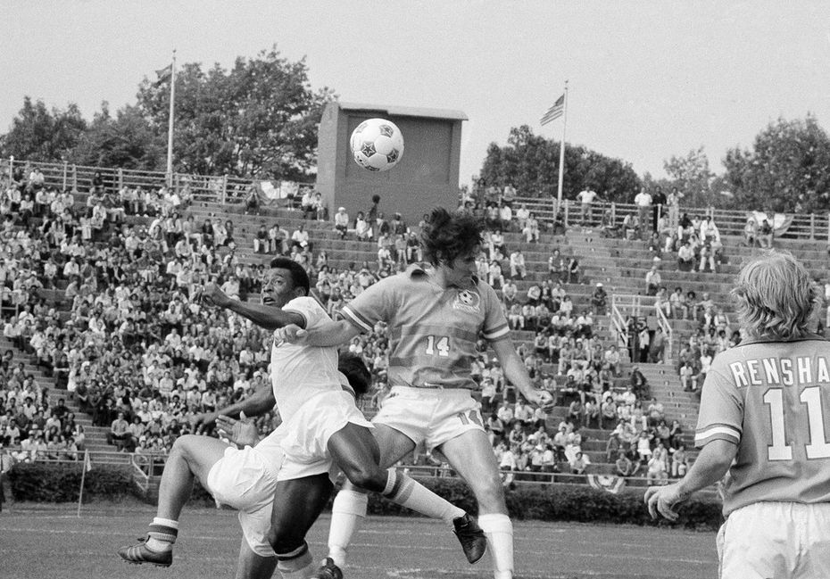 New York Cosmos soccer star Pele goes up against Dallas Tornado Bobby Moffat (14) during an exhibition game at New York's Downing Stadium at Randall's Island on June 15, 1975. It was Pele's debut, and the game ended in a 2-2 tie.