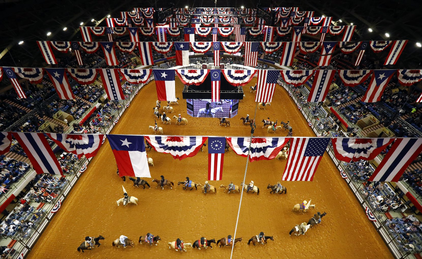 Fprt Worth Stock Show and Rodeo officials, dignitaries, and participants on horseback form a serpentine line during the Grand Entry on Feb. 1 at Will Rogers Memorial Coliseum,. The entry, which kicks of the PRCA rodeo, is a longtime tradition, dating back to the beginning in 1918. The rodeo is moving to the  new Dickies Arena in 2020.