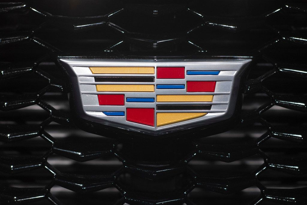 A Cadillac at the New York Auto Show. General Motors says it will get rid of three Cadillac sedans and replace them with two during the next 3½ years.