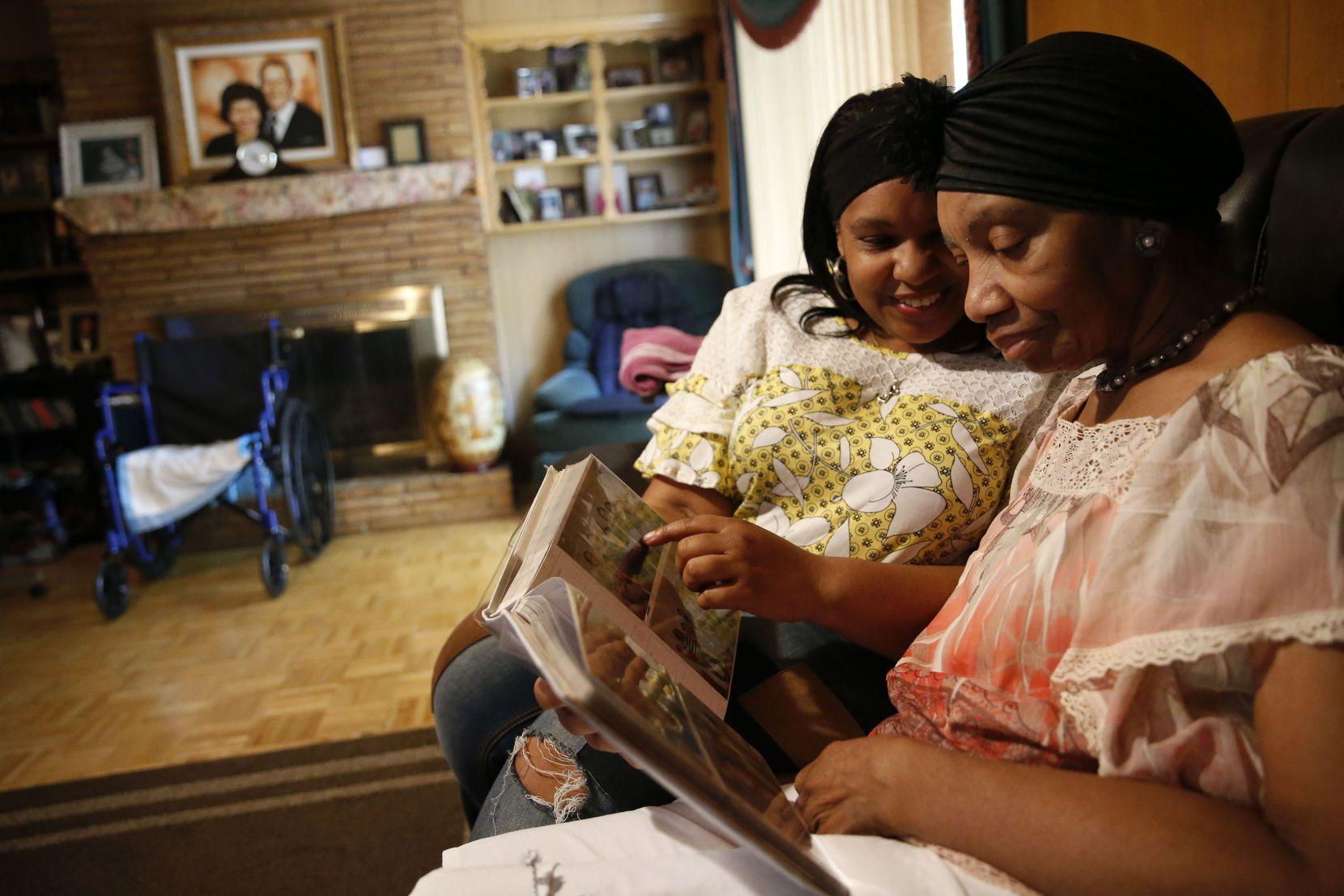 Jennifer Greer (left) looks through a photo album with her mother, Carolyn Greer. Jennifer says flash cards and other brain activities slowed her mother's decline from dementia.