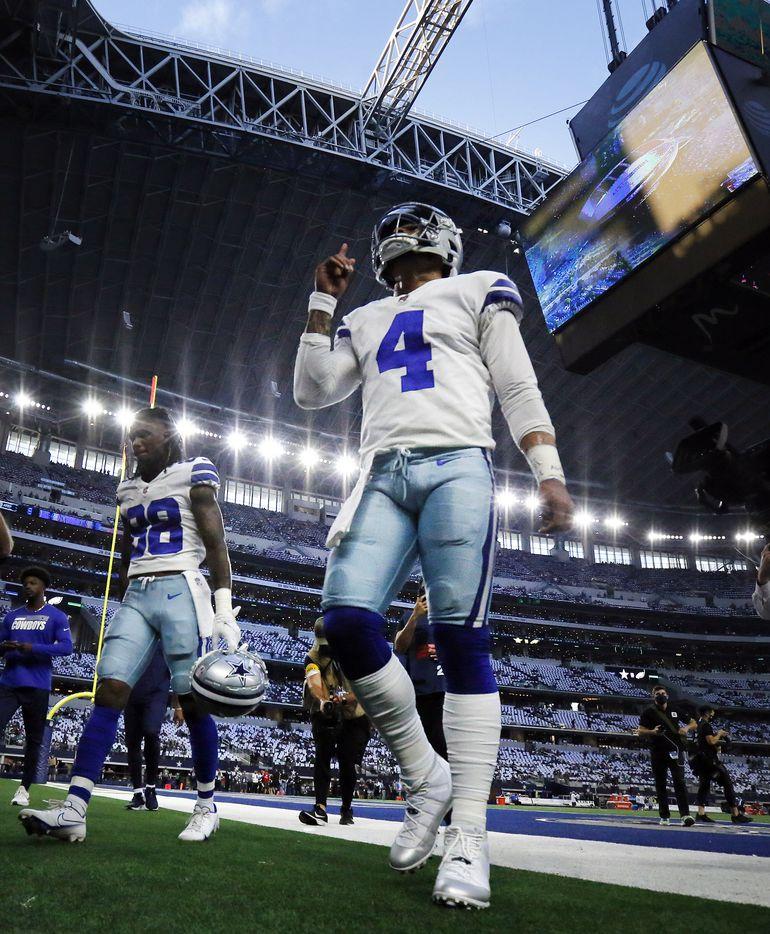 Dallas Cowboys quarterback Dak Prescott (4) points skyward as he comes off the field following pregame warmups at AT&T Stadium in Arlington, Monday, September 27, 2021. (Tom Fox/The Dallas Morning News)