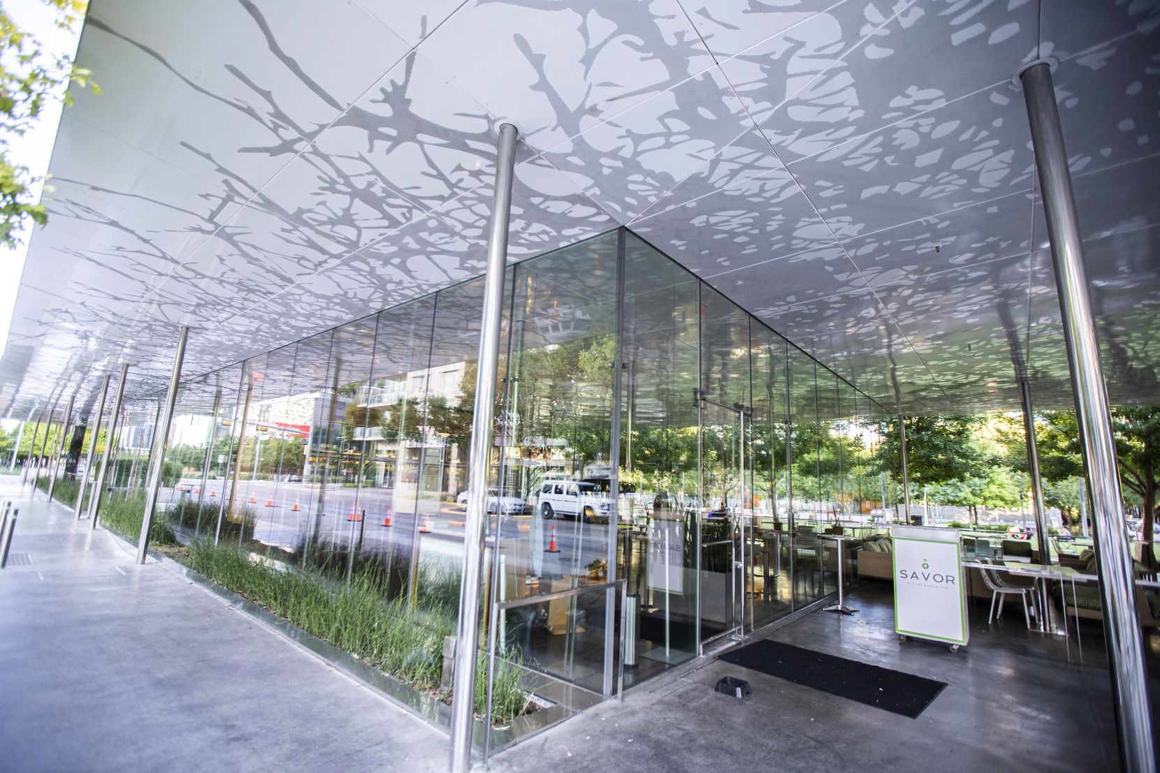 """The restaurant at Klyde Warren Park currently sits empty, after it operated as a high-end restaurant named Savor for many years. Klyde Warren Park president Kit Sawers describes the glass-box restaurant as """"a lantern,"""" and she believes its new life as Mi Cocina will bring more visitors — and more money — to Klyde Warren Park."""