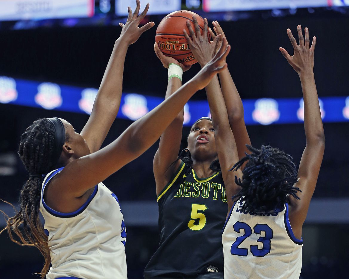 DeSoto Sa'Myah Smith #5 shoots over Cypress Creek defenders. DeSoto vs. Cypress Creek girls basketball Class 6A state championship game on Thursday, March 12, 2021 at the Alamodome.