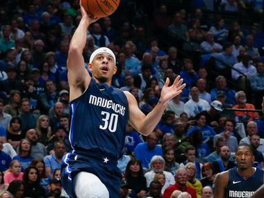 FILE - Mavericks guard Seth Curry (30) puts up a shot during the second quarter of a game against the Wizards on Wednesday, Oct. 23, 2019, at American Airlines Center in Dallas.