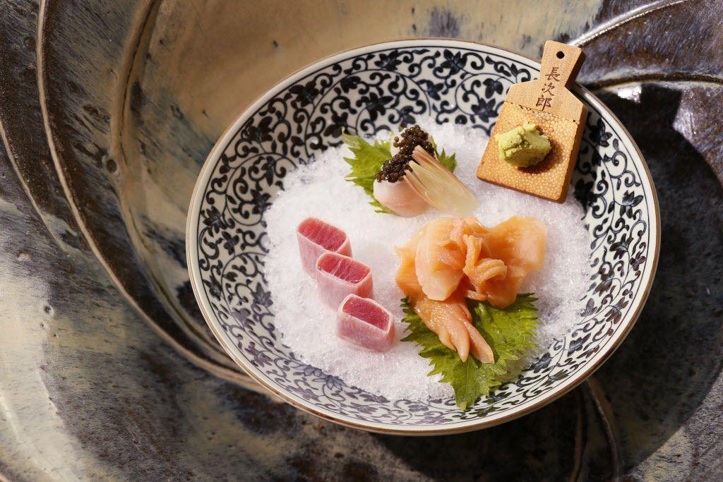 Another sashimi platter (clockwise from top): ishidai (porgy) with caviar; fresh wasabi; aoyagi (surf clam) and maguro (tuna) wrapped in daikon (Japanese radish)