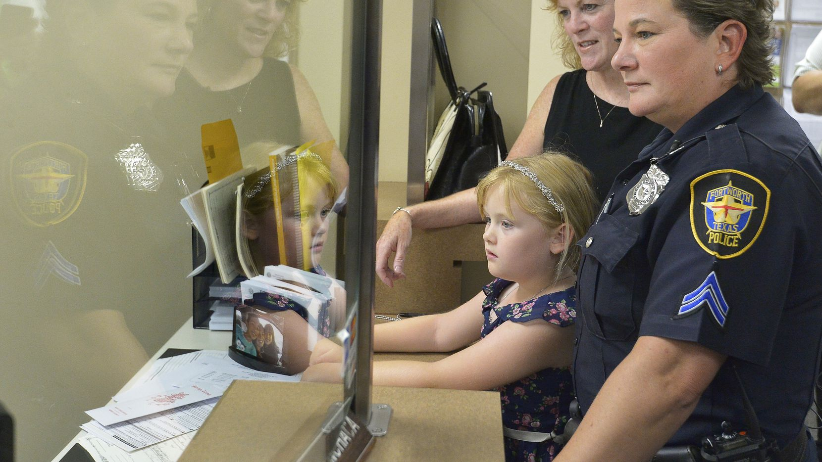 Fort Worth police Cpl. Tracey Knight and Shannon Knight, with their 6-year-old daughter, Evan, were Tarrant County's first gay couple to receive a marriage license after the Supreme Court's ruling June 26.