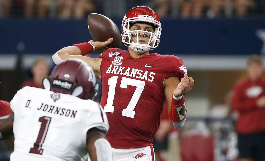 Arkansas quarterback Nick Starkel (17) throws as Texas A&M linebacker Buddy Johnson (1) closes in during the first half of an NCAA college football game Saturday, Sept. 28, 2019, in Arlington, Texas.