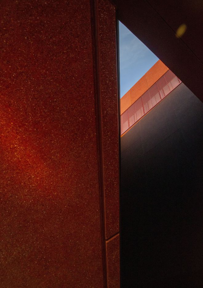 A triangular skylight hovers above the entrance to the Ruby City art center.