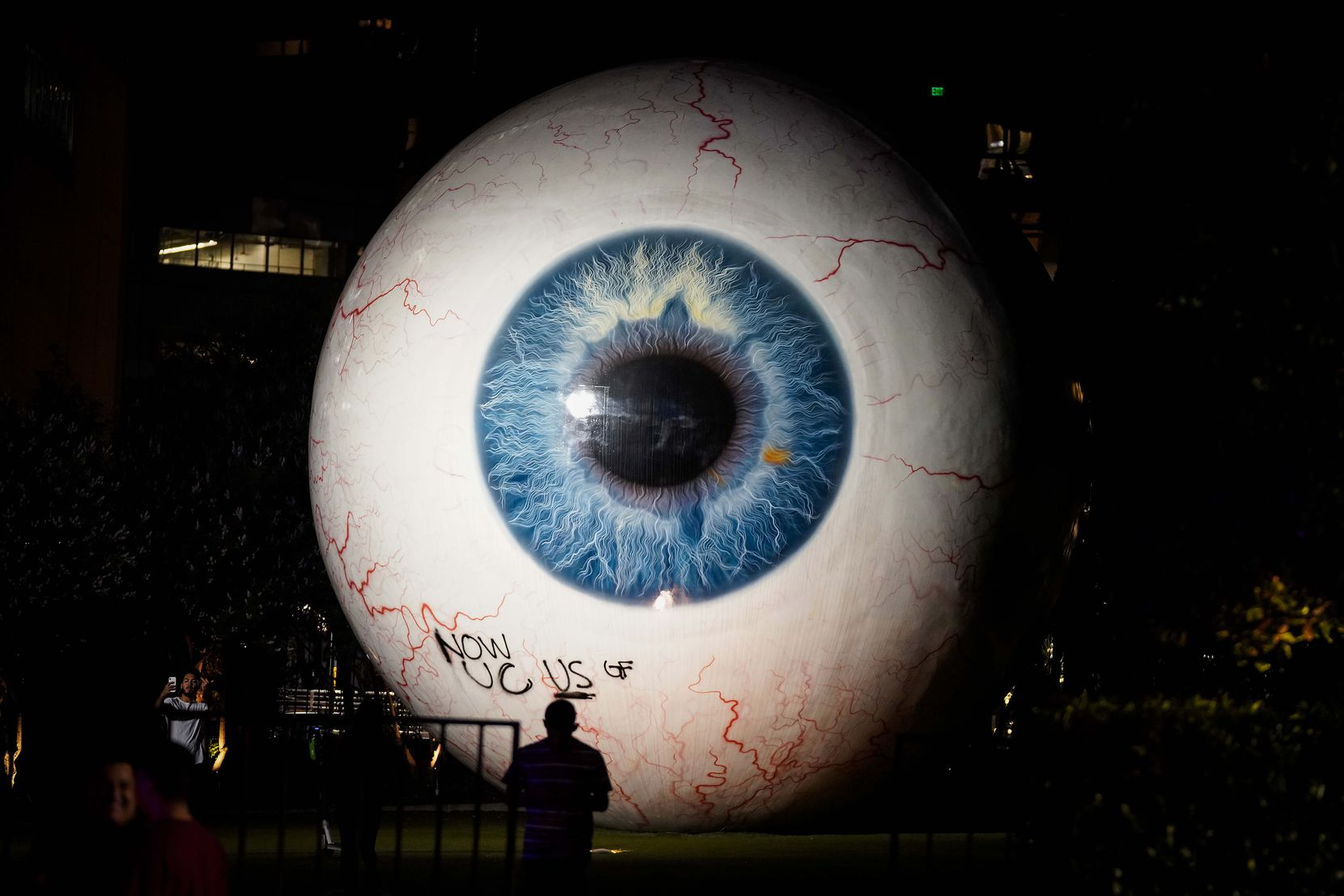 """Graffiti is seen on the giant eyeball sculpture, titled"""" Eye,"""" following a protest against police brutality in the early morning hours of Saturday, May 30, 2020, in Dallas. The protest was organized by Next Generation Action Network in response to the in-custody death of George Floyd in Minneapolis."""