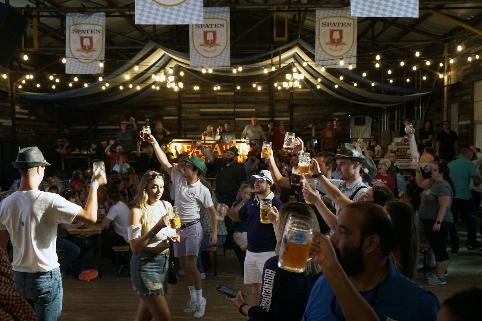 """People toast during the """"Ein Prosit"""" sing-a-long at the 2018 Octoberfest at Panther Island in Fort Worth. The 2021 event will be held Sept. 23-25."""