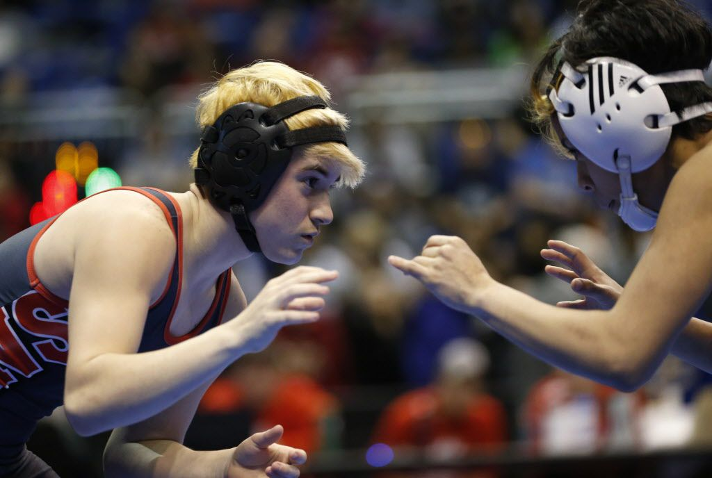 Euless Trinity's Mack Beggs wrestles Katy Morton Ranch's Chelsea Sanchez in the championship match of the 6A girls 110 weight class during the UIL Wrestling State Tournament at Berry Center in Cypress on Saturday, February 25, 2017. Beggs defeated Sanchez to win the championship. (Vernon Bryant/The Dallas Morning News)