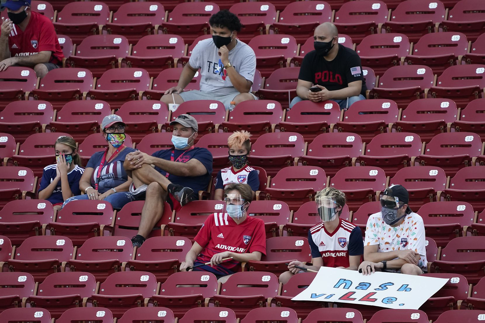 Socially distant fans watch FC Dallas during the first half of an MLS soccer game against Nashville SC at Toyota Stadium on Wednesday, Aug. 12, 2020, in Frisco, Texas. (Smiley N. Pool/The Dallas Morning News)