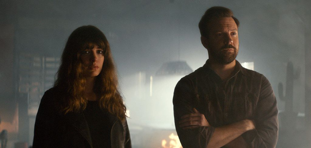 In this image released by Neon, Jason Sudeikis (right) and Anne Hathaway appear in a scene from Colossal.
