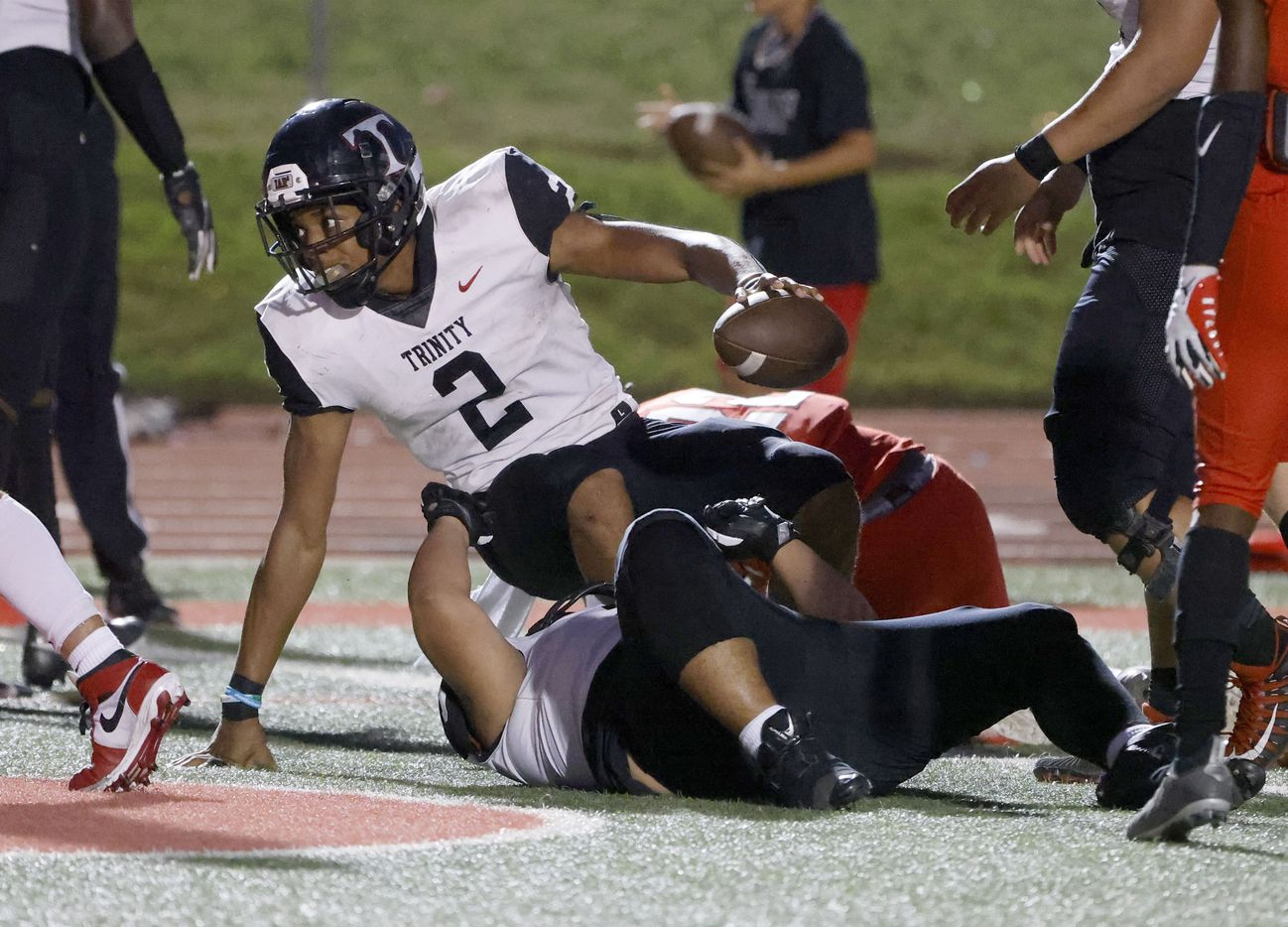 Euless Trinity quarterback Ollie Gordon (2) scores a rushing touchdown against Colleyville Heritage during the first half of a high school football game in Grapevine, Texas on Friday, Sept. 10, 2021. (Michael Ainsworth/Special Contributor)