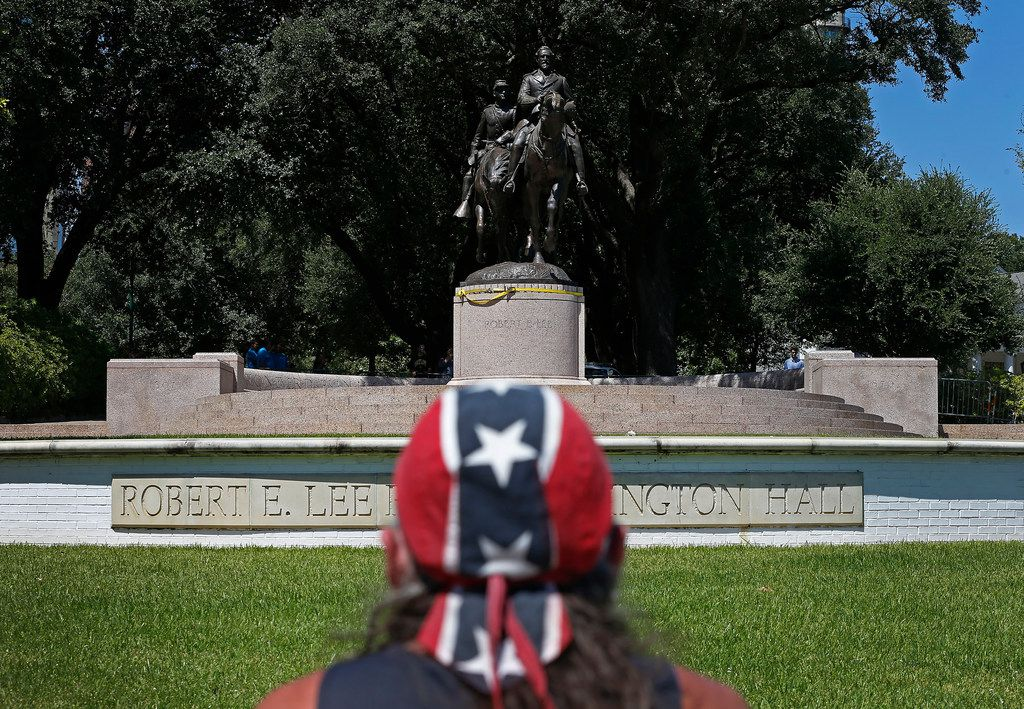 Johnny Carpenter looks at the statue of Robert E. Lee that still stands in Oak Lawn almost a week after the Dallas City Council voted to have it removed.