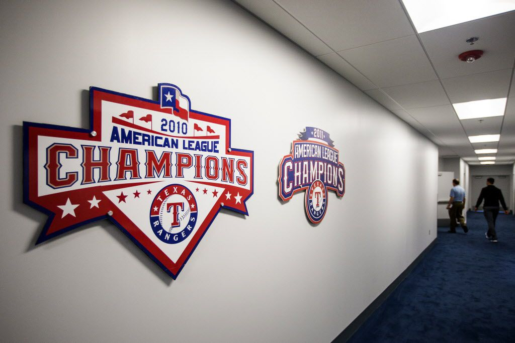 Reminders of the team's 2010 and 2011 American League championships hang in a hallway leading to the clubhouse of the Texas Rangers newly renovated spring training facility during a media tour on Thursday, Feb. 18, 2016, in Surprise, Ariz. (Smiley N. Pool/The Dallas Morning News)