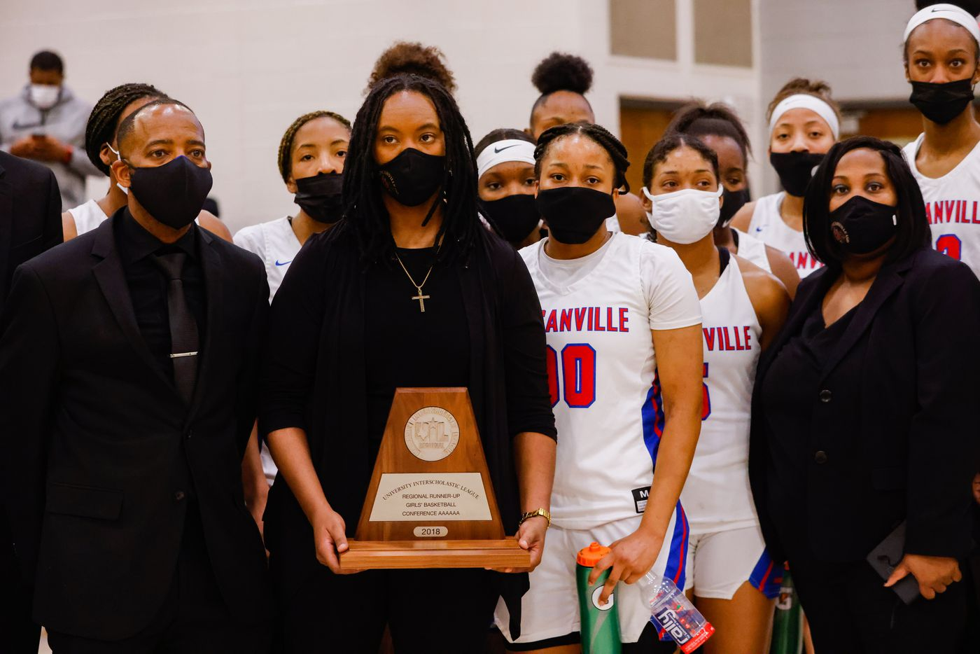 Duncanville's coach LaJeanna Howard holds the Regional Runner-up trophy following a girls basketball Class 6A Region II UIL game against DeSoto in Waxahachie on Tuesday, March 2, 2021. DeSoto won 52-39.  (Juan Figueroa/ The Dallas Morning News)