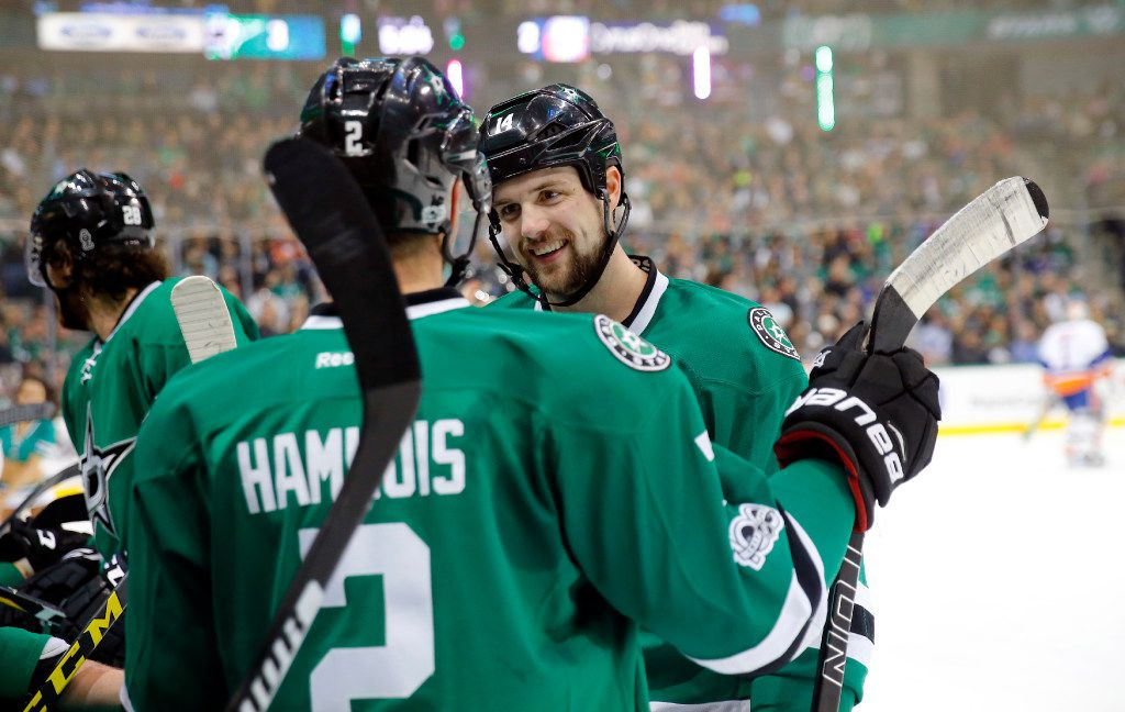 Dallas Stars left wing Jamie Benn (14) laughs with defenseman Dan Hamhuis (2) during a second period timeout at the American Airlines Center in Dallas, Thursday, March 2, 2017. (Tom Fox/The Dallas Morning News)