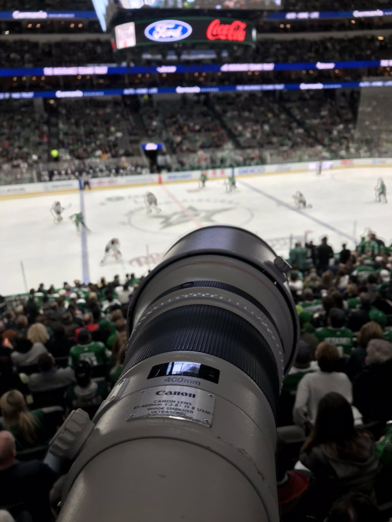 Ashley Landis, staff visual journalist at The Dallas Morning News, photographs the third period of the Dallas Stars vs. Buffalo Sabres game from an elevated spot at American Airlines Center in Dallas on Jan. 16, 2020.