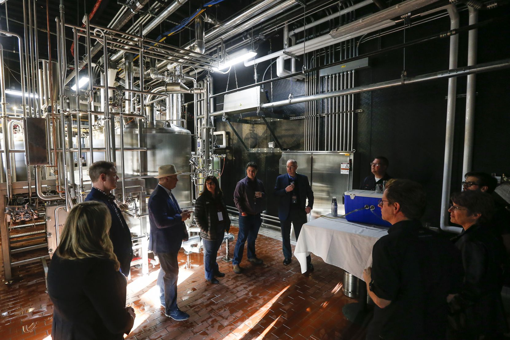 A group tours during an open house of Revolver Brewing BLDG 5, a new working brewery at Texas Live.