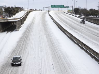 Snow covers Woodall Rodgers Freeway in Downtown Dallas on Monday.
