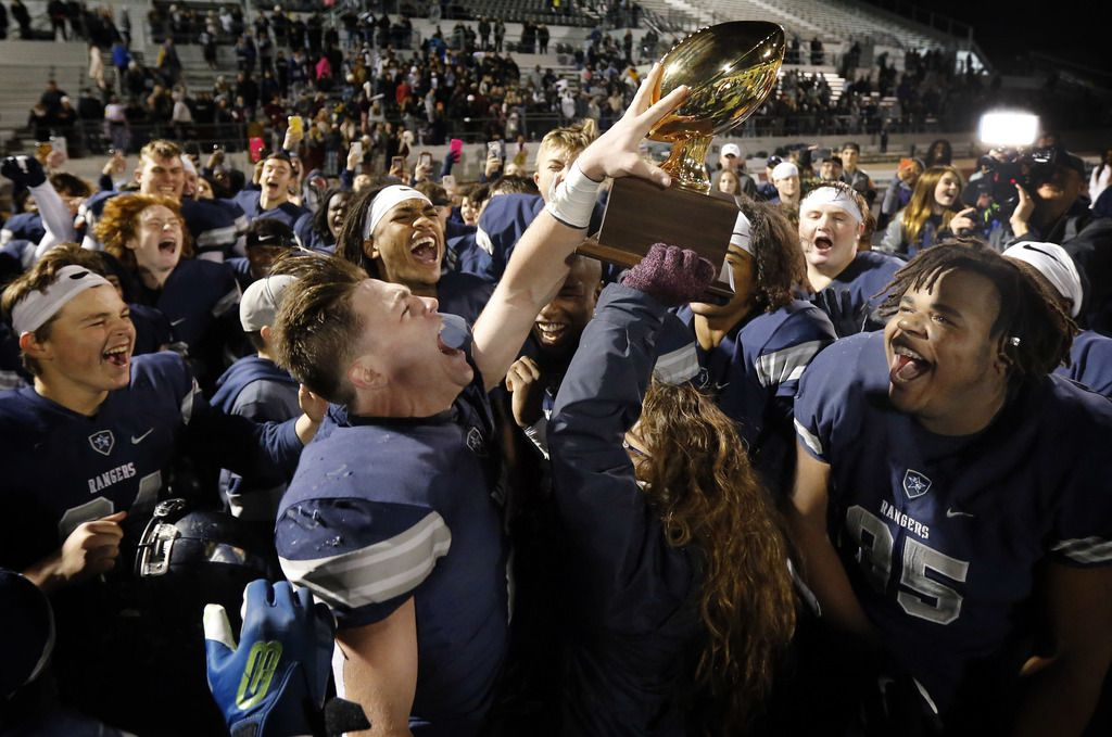Frisco Lone Star players including receiver Jake Bogdon (2) and Cameron Jones (95) celebrate withe the trophy after defeating Lancaster in their Class 5A Division I Regional championship at Wilkerson-Sanders Stadium in Rockwall, Texas, Friday, December 6, 2019. (Tom Fox/The Dallas Morning News)