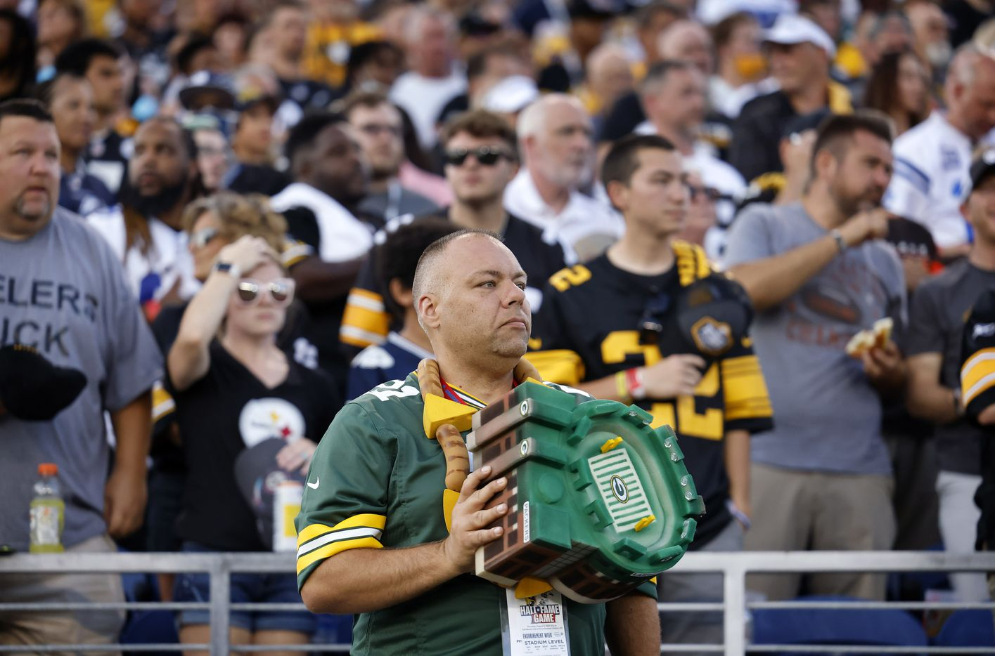A Green Bay Packers fan holds his Lambeau Field hat over his heart during the playing of the national anthem before the Cowboys-Steelers preseason game at Tom Benson Hall of Fame Stadium in Canton, Ohio, Thursday, August 5, 2021. (Tom Fox/The Dallas Morning News)