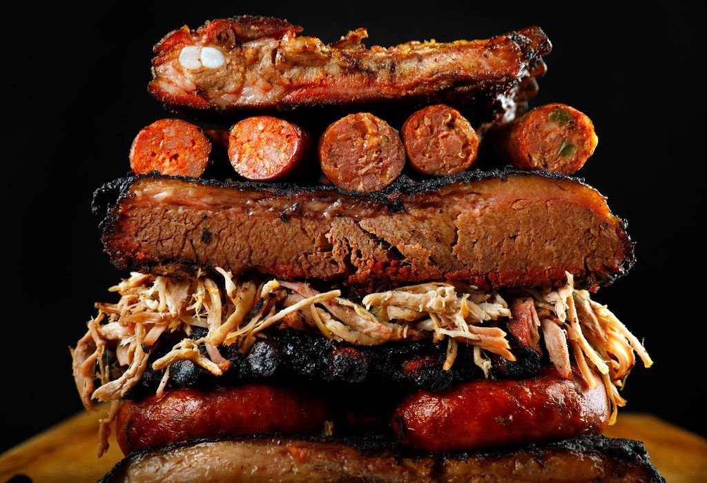 Brisket, ribs, sausage, and pulled pork are piled high, Thursday, July 12, 2018. Barbecue can be part of the keto diet. (photography by Tom Fox/The Dallas Morning News, food styling by Michael Hamtil/The Dallas Morning News)