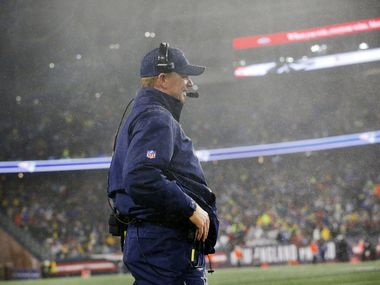 Dallas Cowboys head coach Jason Garrett was not immune to the driving wind and rain as he watched from the sidelines against the New England Patriots at Gillette Stadium in Foxborough, Massachusetts Sunday, November 24, 2019.