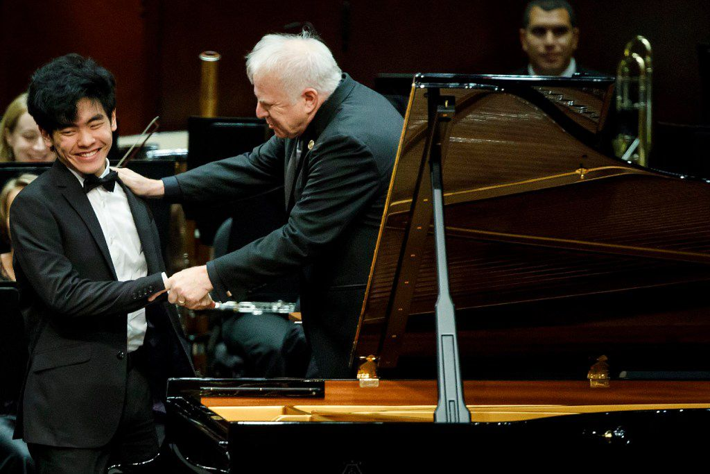 Daniel Hsu of the USA is congratulated by conductor Leonard Slatkin after performing a piano concerto with the Fort Worth Symphony Orchestra in the final round of the Van Cliburn International Piano Competition at Bass Performance Hall on Saturday, June 10, 2017, in Fort Worth. (Smiley N. Pool/The Dallas Morning News)