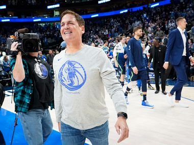 FILE - Mavericks owner Mark Cuban celebrates after a 109-91 win against the 76ers at American Airlines Center on Saturday, Jan. 11, 2020, in Dallas.
