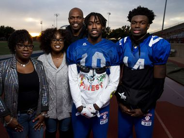 Ketra Beason, left, Rayshauna Beason, Archie Beason, Marquez Beason, and Zariah Beason, right, poses for a portrait at Duncanville High School in Duncanville, Texas on Monday, Dec. 17, 2018.  Marquez Beason, a 4 star recruit and 14th best of recruit in the class of 2019, will sign with Illinois on Wednesday. In 2011, Ketra and Archie Beason became their nephew's, Marquez Beason's, legal guardians. (Shaban Athuman/The Dallas Morning News)