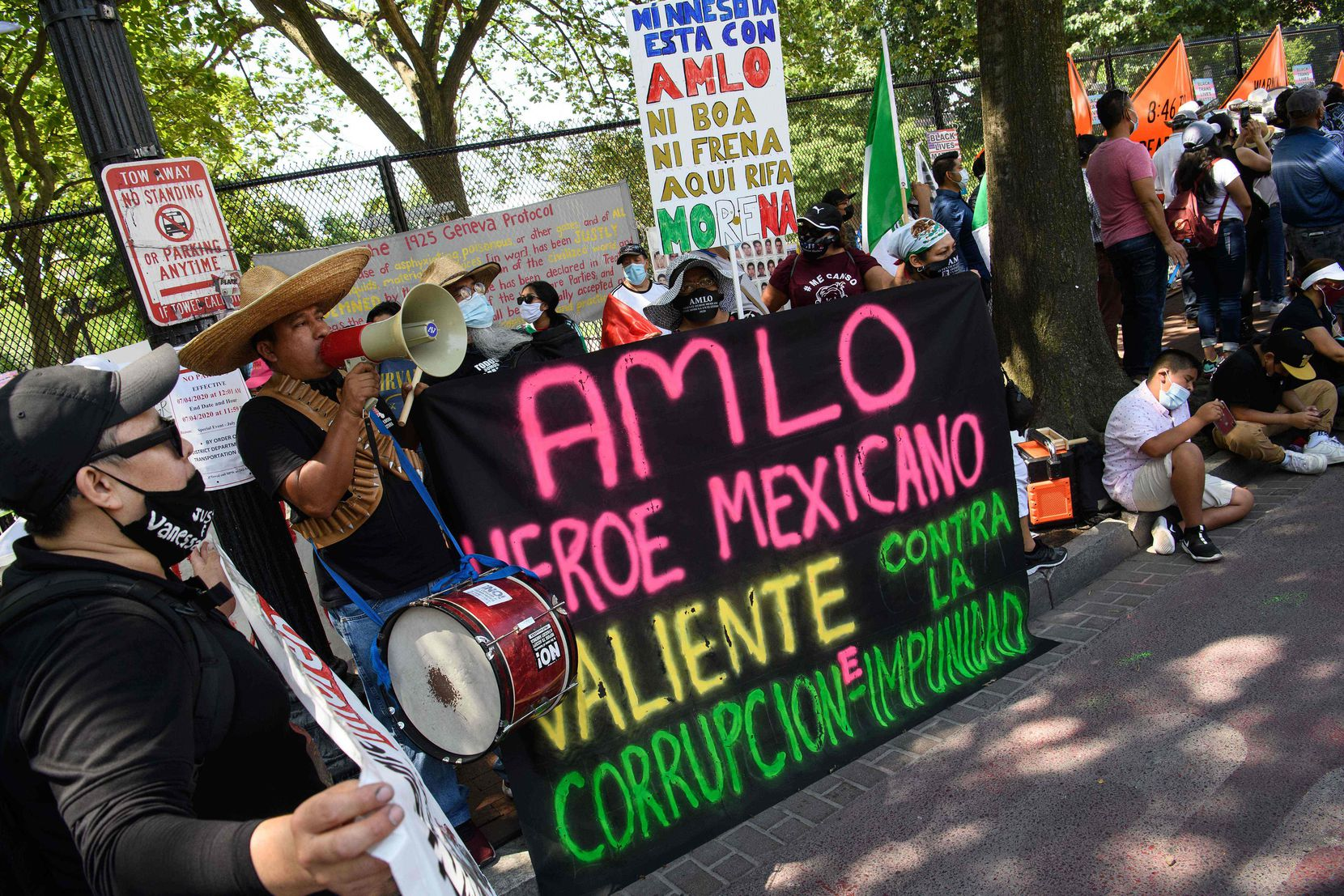 Supporters of Mexican President Andres Manuel Lopez Obrador gather near the White House on July 8, 2020 ahead of his meeting with President Donald Trump.