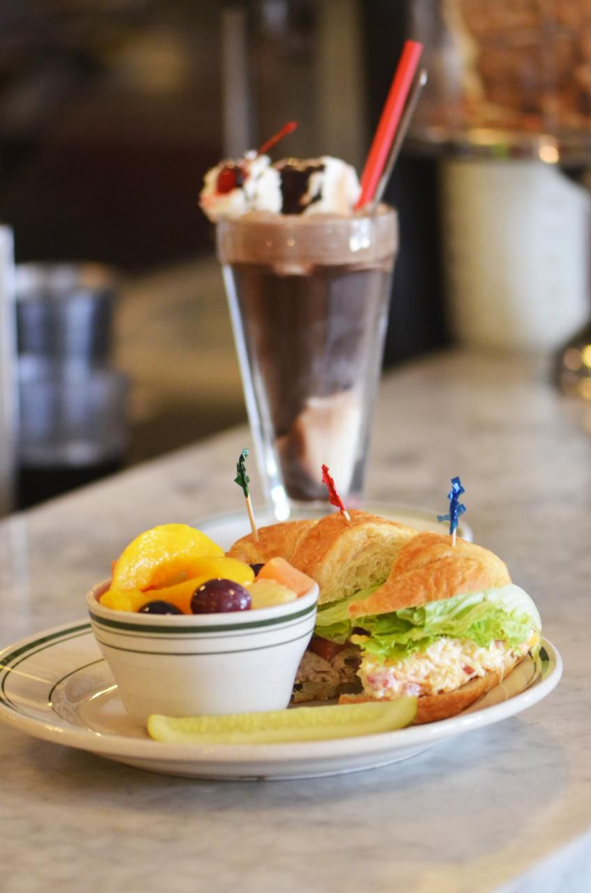 Star Drug's cool sandwich trio pairs with a chocolate soda for a refreshing break at the counter after a long day in the sun.