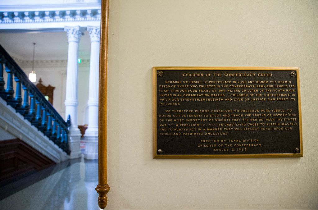 """A plaque entitled """"Children of the Confederacy Creed"""" hangs in a hallway on the ground floor of the Texas state Capitol, on the third day of the 86th Texas legislature on Thursday, January 10, 2019 in Austin, Texas. (Ashley Landis/The Dallas Morning News)"""
