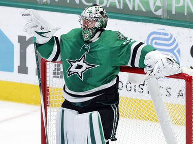 Dallas Stars goaltender Anton Khudobin (35) rests on the goal during a second period timeout against the Carolina Hurricanes at the American Airlines Center in Dallas, Tuesday, April 27, 2021. (Tom Fox/The Dallas Morning News)