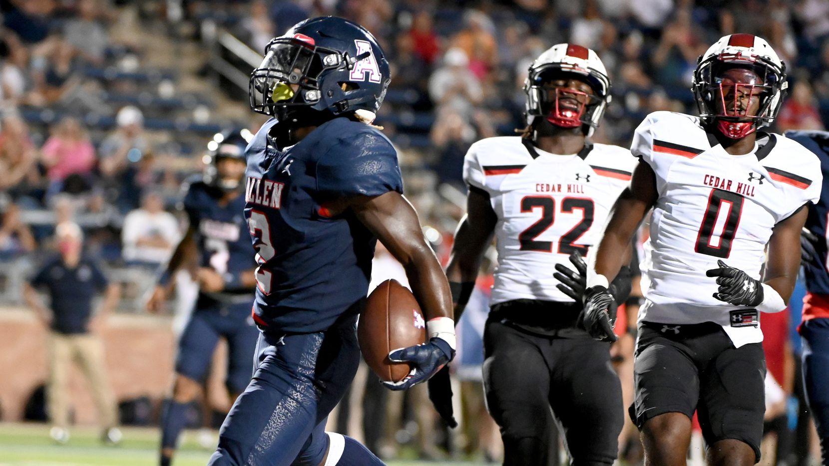 Allen's Jaylen Jenkins (2) runs in front of Cedar Hill's Kylan Salter (22) and Cedar Hill's Keandre Jackson (0) for a touchdown in the first half of a high school football game between Cedar Hill and Allen, Friday, Sept. 10, 2021, in Allen, Texas. (Matt Strasen/Special Contributor)
