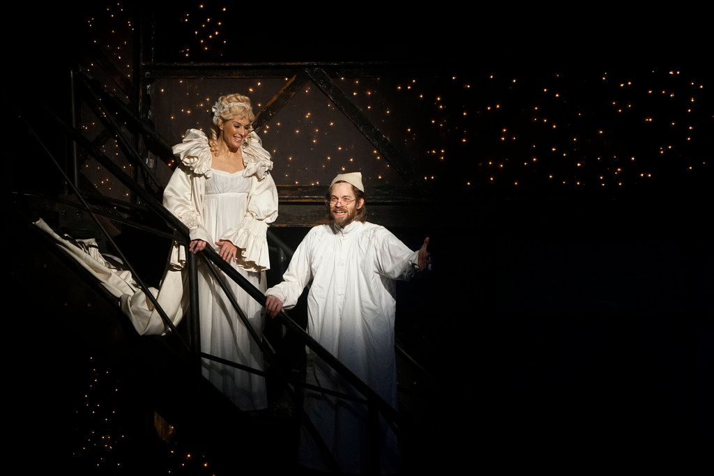 """Cara Statham Serber is the Ghost of Christmas Past and Alex Organ is Ebenezer Scrooge in Dallas Theater Center's """"A Christmas Carol,"""" at the Wyly Theatre through Dec. 30."""