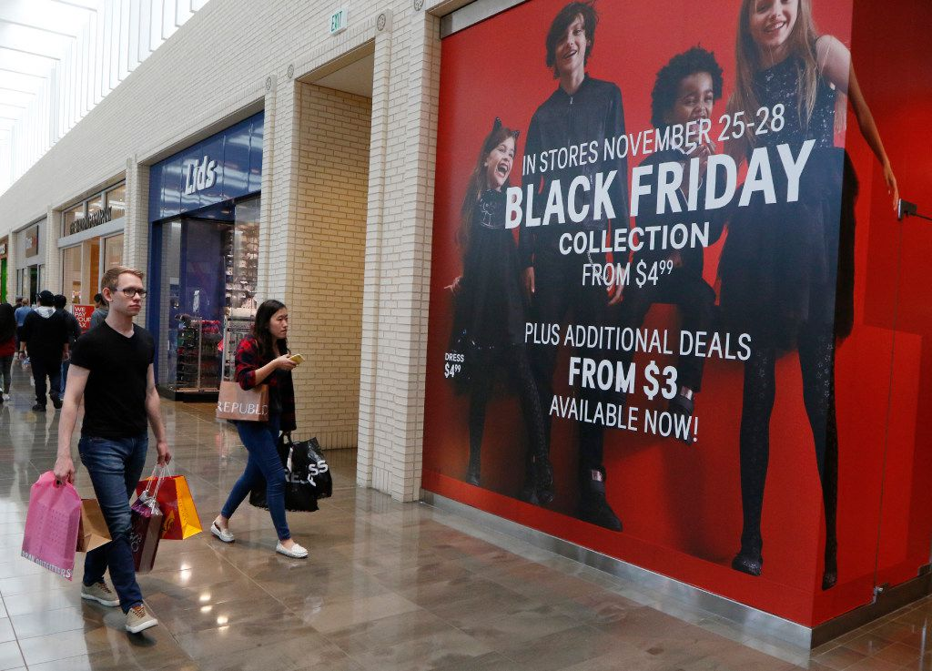 Lincoln Turner, 21, left, and Rachel Kao, 21, shop at NorthPark Center on Black Friday, November 25, 2016 in Dallas, Texas. (David Woo/The Dallas Morning News)