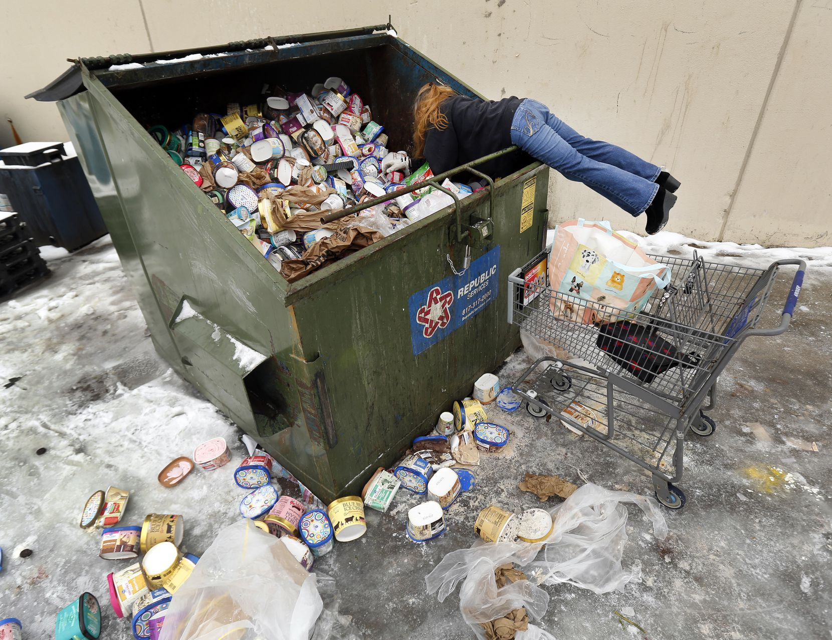 """After seeing a posting on Facebook, LaDonna (no last name given) drove from Johnson County to collect some of the dumpsters-full of ice cream thrown out at a Southwest Arlington Kroger store, Wednesday, February 17, 2021. LaDonna said she's collecting the frozen goods for her neighbors. """"I do it because they would do it for me."""", she said. Rolling power outages this week have forced businesses to clear merchandise that needs refrigeration. The power is back Wednesday and the store is open."""
