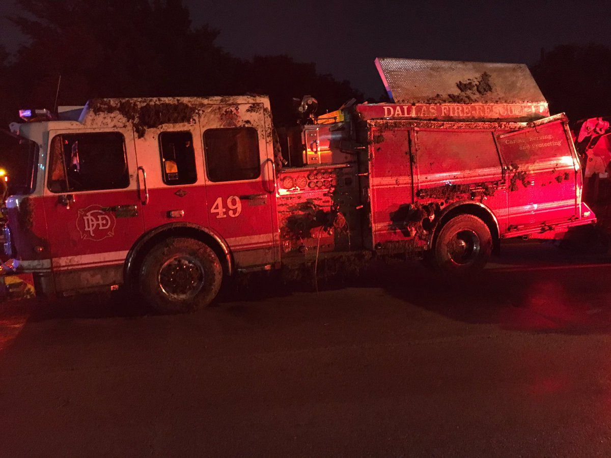 A Dallas firefighter was injured when an engine rolled on its side in central Oak Cliff.