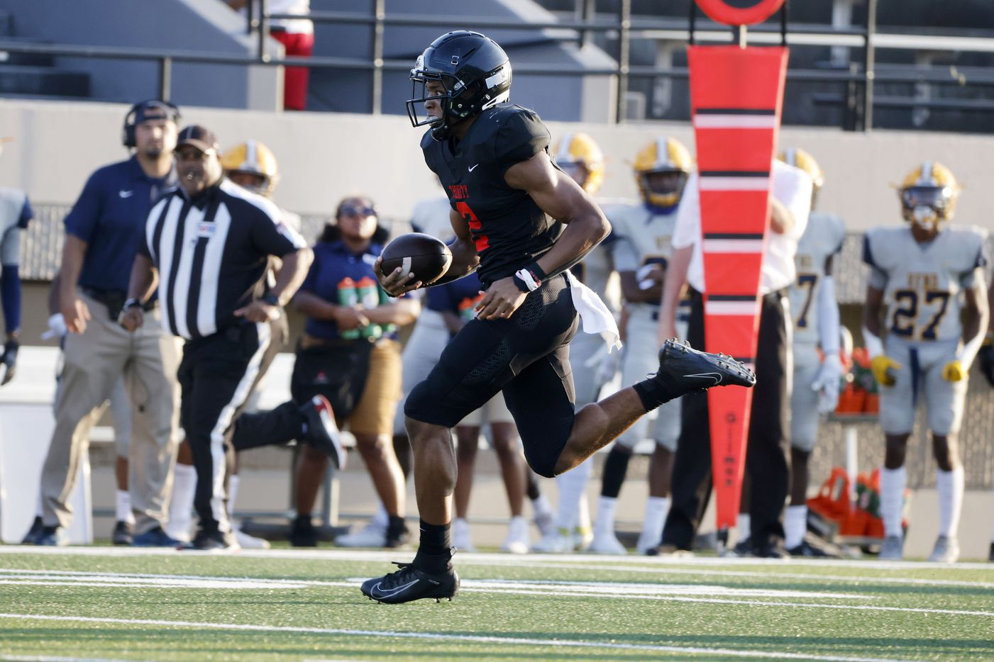 Euless Trinity quarterback Ollie Gordon runs for the first touchdown against Arlington Lamar during the first half of their high school football game in Bedford, Texas on Aug. 26, 2021. (Michael Ainsworth/Special Contributor)