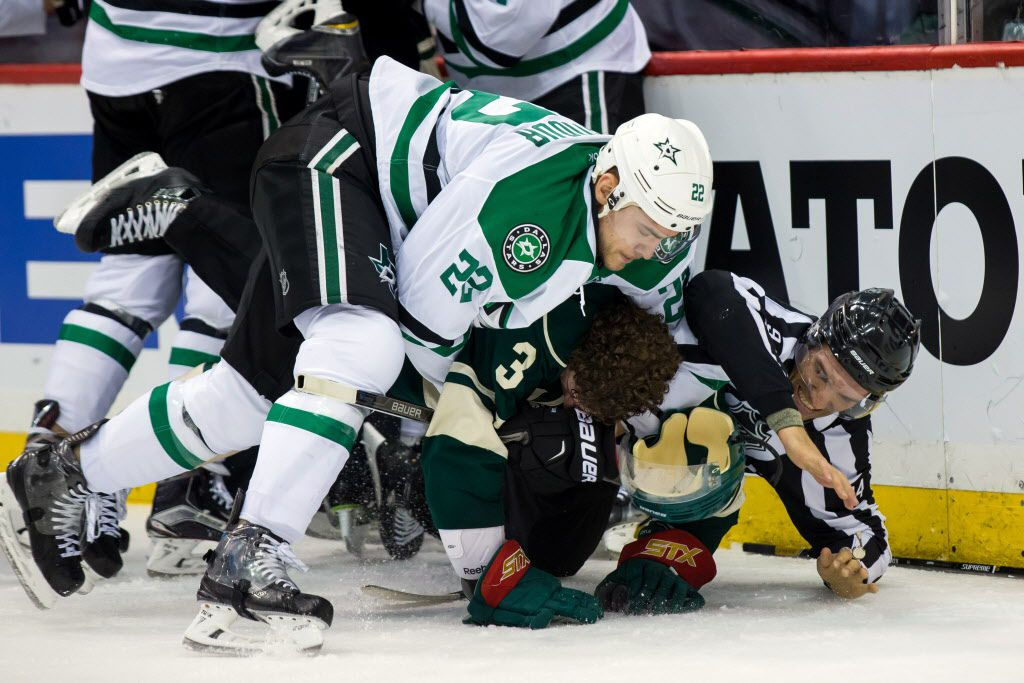 Apr 18, 2016; Saint Paul, MN, USA; Dallas Stars forward Colton Sceviour (22) and Minnesota Wild forward Charlie Coyle (3) wrestle after the whistle in the second period in game three of the first round of the 2016 Stanley Cup Playoffs at Xcel Energy Center. Mandatory Credit: Brad Rempel-USA TODAY Sports