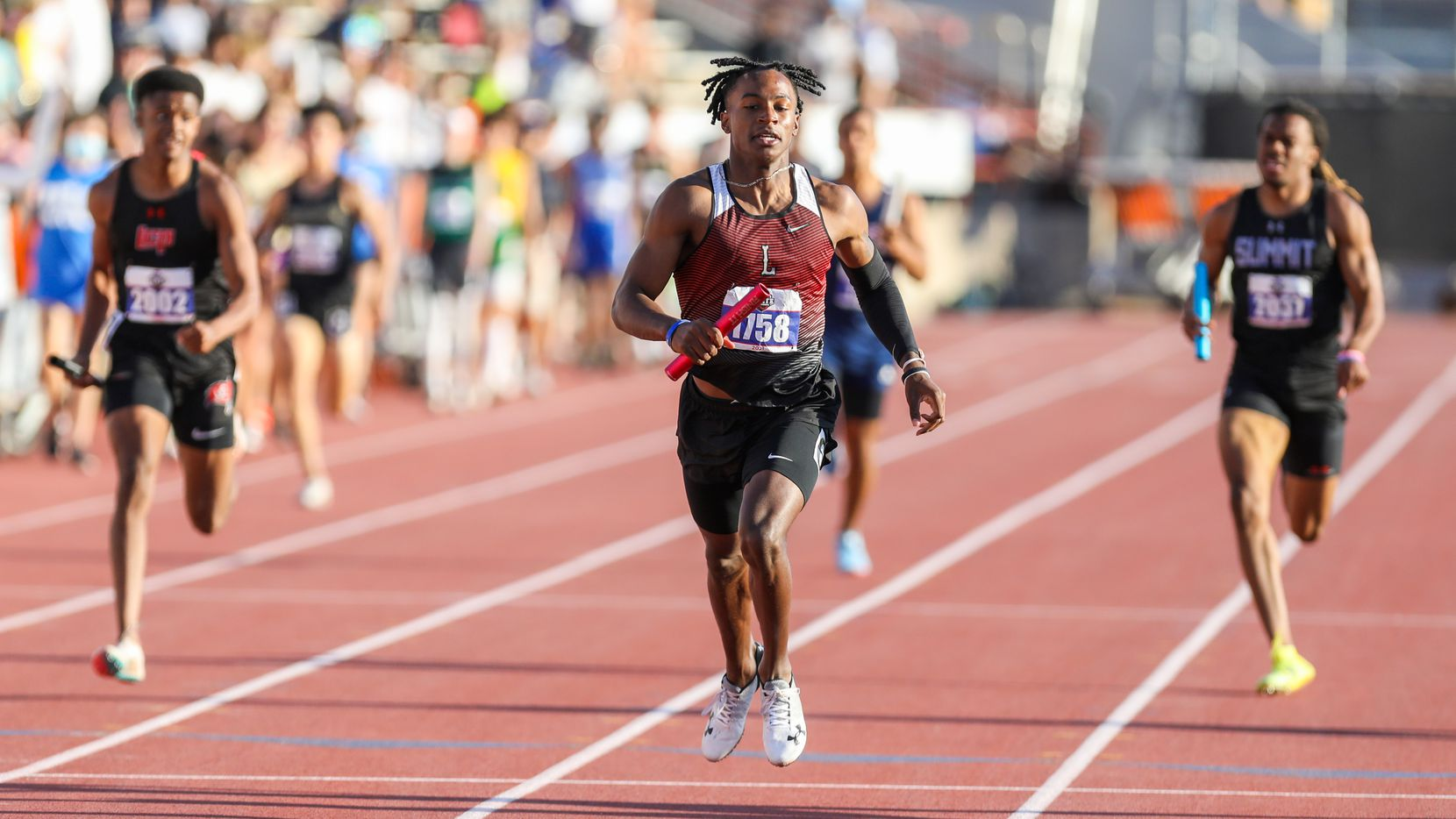 Frisco Liberty's Evan Stewart runs towards the finish line in the 5A Boys 4x200 relay during the UIL state track meet at the Mike A. Myers Stadium, at the University of Texas on May 7, 2021 in Austin, Texas. Frisco Liberty placed second in the event.