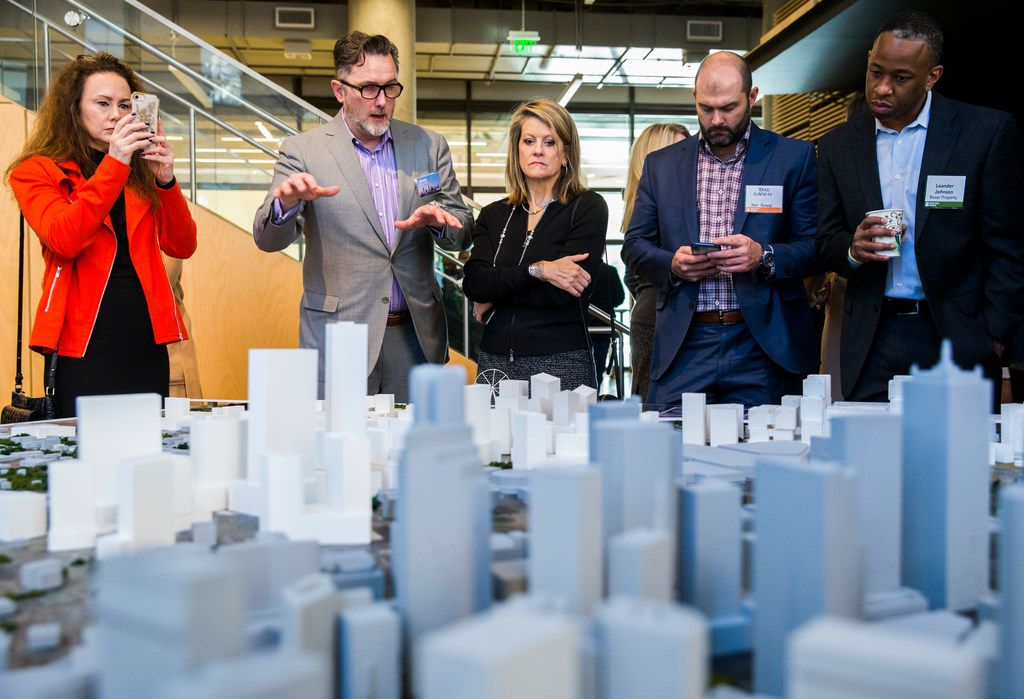 Craig J. Kolstad, (second from left) Associate Principal and Senior Vice President Director of Design at HKS, shows off a model of what was offered to Amazon as part of a possible Dallas HQ2 location is displayed during an Urban Land Institute panel discussion on Tuesday, February 12, 2019, at HKS in downtown Dallas.